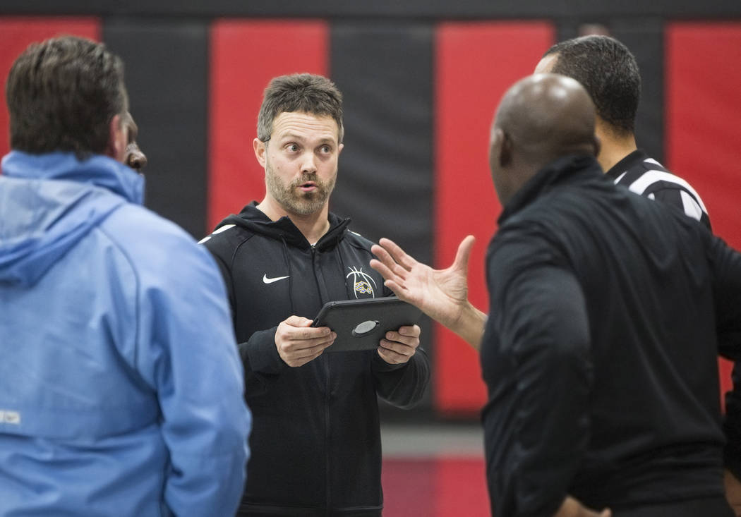 Sierra Vista head coach Eric Markuson, middle, talks to referees about the circumstances that led to the Mountain Lions game with Bonanza High School being suspended and ultimately forfeited after ...
