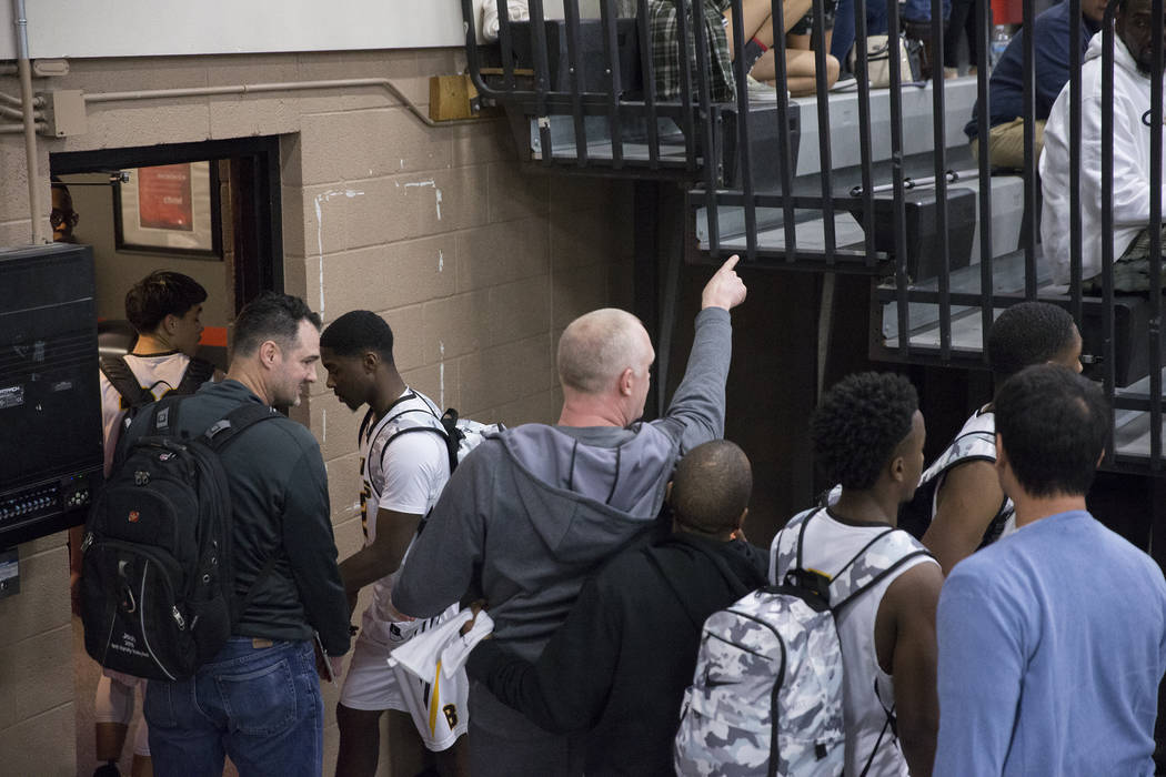 Bonanza head coach Dan Savage, middle, points at Sierra Vista fans after the Bengals game with the Mountain Lions was suspended and ultimately forfeited after an on court incident at halftime duri ...
