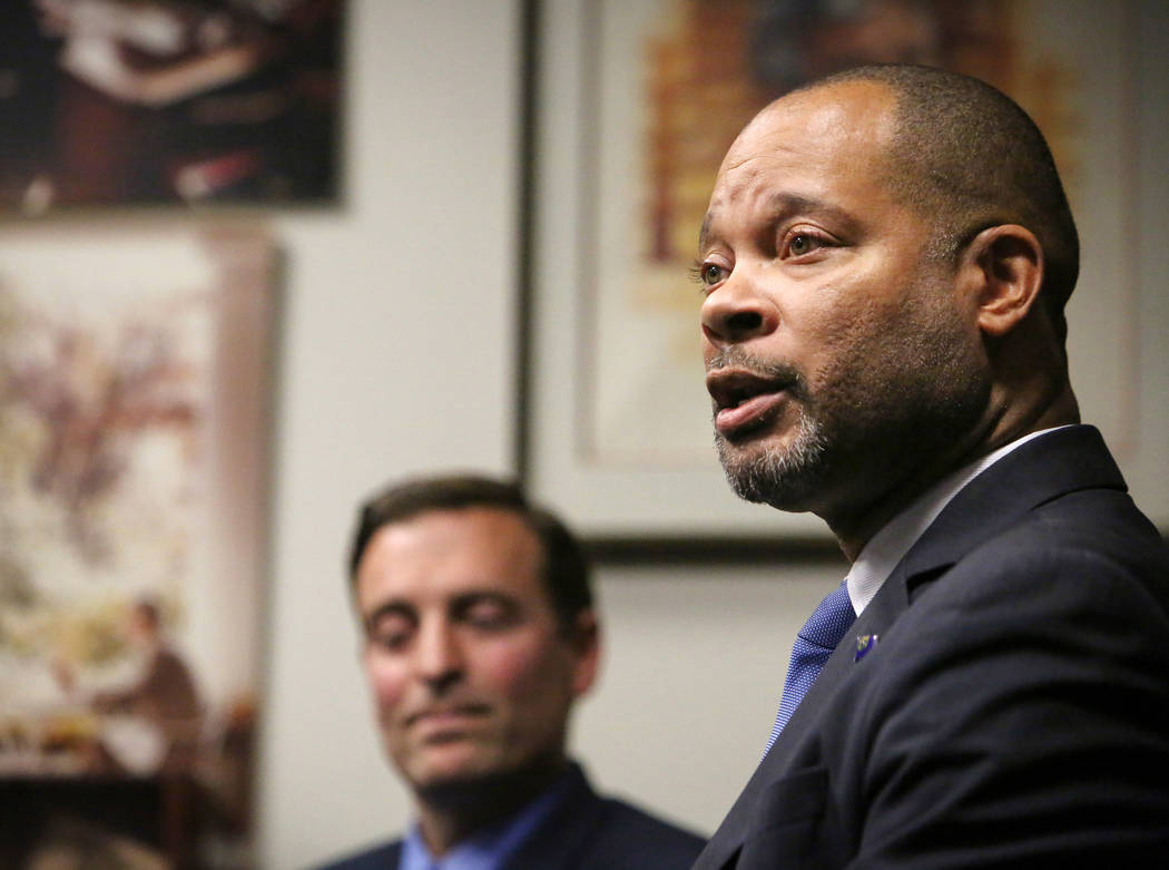 Nevada's incoming Democratic Attorney General Aaron Ford speaks as outgoing Republican Attorney General Adam Laxalt listens during a press briefing in Las Vegas, Monday, Dec. 17, 2018. Caroline Br ...