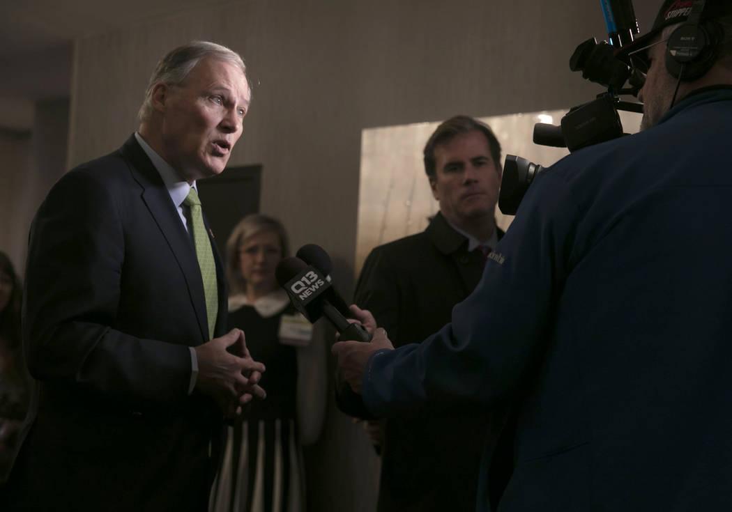 Washington Gov. Jay Inslee speaks with the media at the annual Washington Cannabis Summit, Friday, Jan. 4, 2019, in SeaTac, Wash. (Erika Schultz/The Seattle Times via AP)