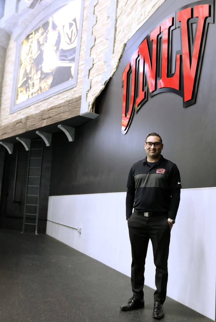 Zee Khan, General Manager of the UNLV hockey program, stands under the university's logo at City National Arena in Las Vegas, Friday, Dec. 28, 2018. Heidi Fang Las Vegas Review-Journal @HeidiFang