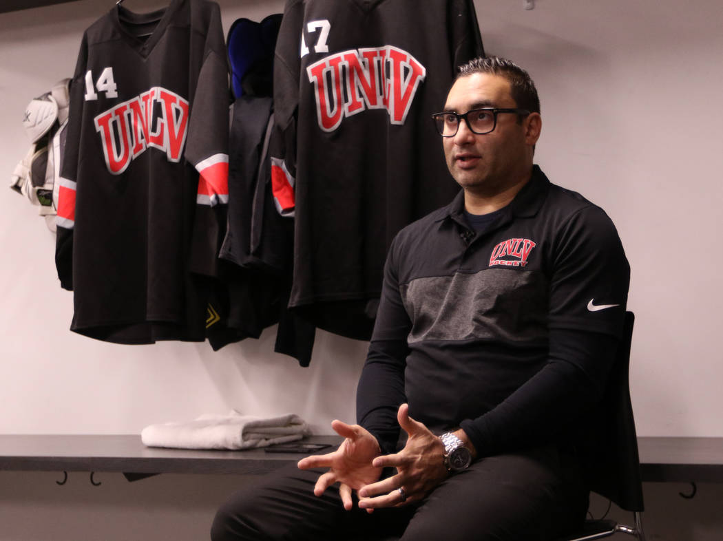 c7b5e9b737d Zee Khan, General Manager of the UNLV hockey program, is interviewed at  City National