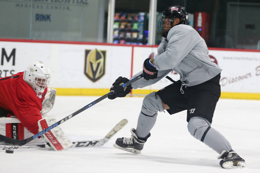 Jared Turcotte, right, takes a shot against goalie Ben Giesbrech during an UNLV hockey team practice at City National Arena in Las Vegas, Friday, Jan. 4, 2019. Erik Verduzco Las Vegas Review-Journ ...