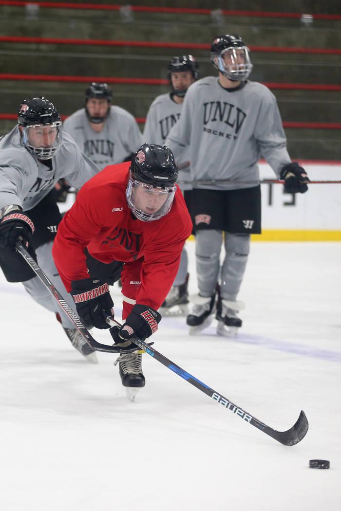 John Moeller goes for the puck during an UNLV hockey team practice at City National Arena in Las Vegas, Friday, Jan. 4, 2019. Erik Verduzco Las Vegas Review-Journal @Erik_Verduzco