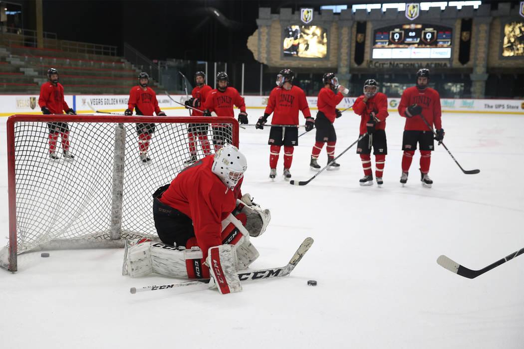 Goalie Ben Giesbrecht makes a stop during an UNLV hockey team practice at City National Arena in Las Vegas, Friday, Jan. 4, 2019. Erik Verduzco Las Vegas Review-Journal @Erik_Verduzco