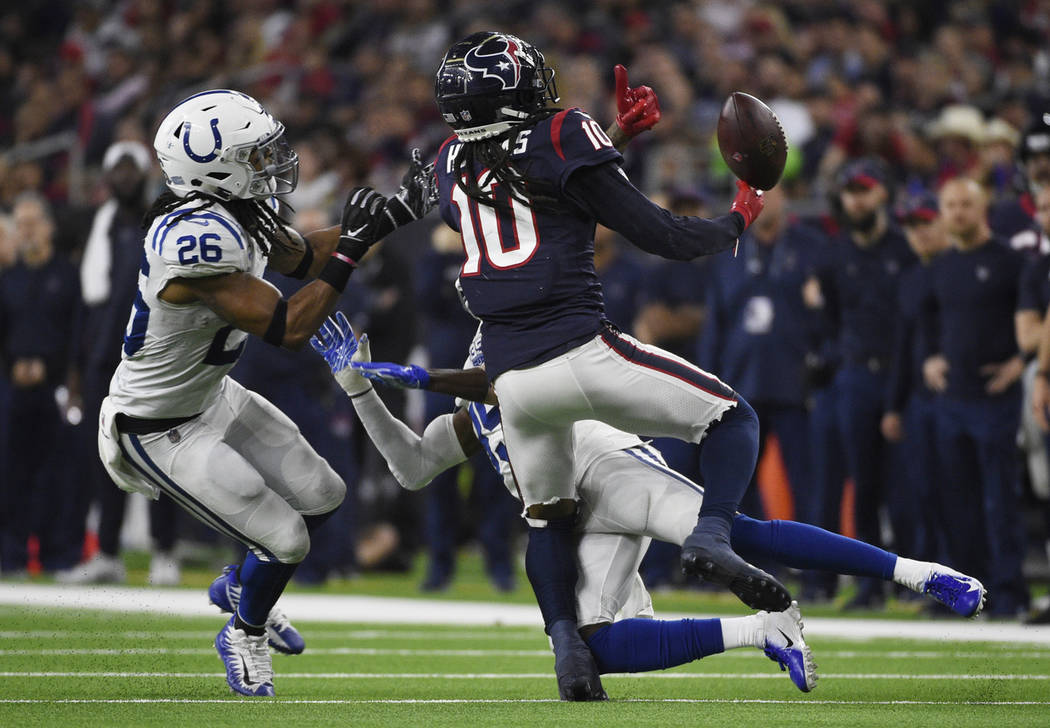 Indianapolis Colts cornerback Pierre Desir (35) and strong safety Clayton Geathers (26) break up a pass intended for Houston Texans wide receiver DeAndre Hopkins (10) during the second half of an ...