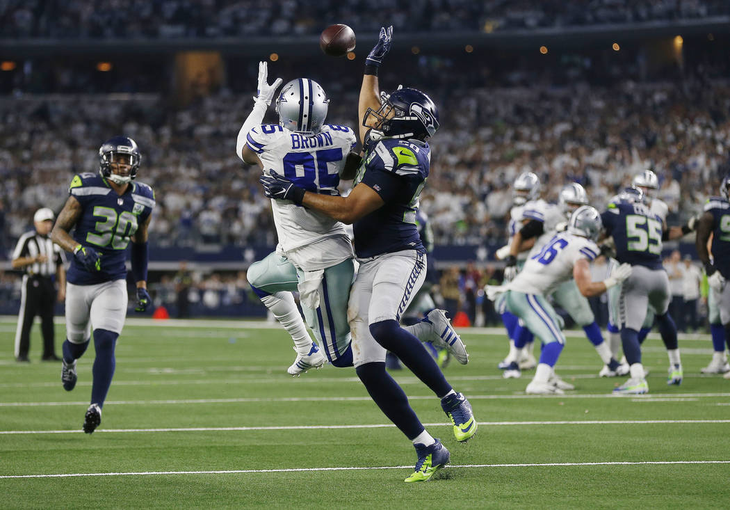 Seattle Seahawks outside linebacker K.J. Wright (50) defends against Dallas Cowboys wide receiver Noah Brown (85) during the second half of the NFC wild-card NFL football game in Arlington, Texas, ...
