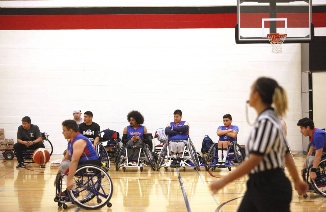 The Rancho Renegades watch their teammates compete against the Las Vegas Yuccas during the Wheelchair Basketball Division I-II Tournament at UNLV in Las Vegas, Sunday, Jan. 6, 2019. Las Vegas Yucc ...