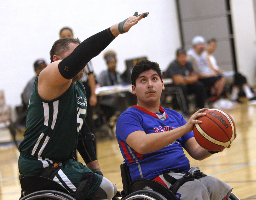 Rancho Renegades Genaro Perez (10) attempts to shoot past Las Vegas Yuccas Ahmad Karimzada (15) during the Wheelchair Basketball Division I-II Tournament at UNLV in Las Vegas, Sunday, Jan. 6, 2019 ...