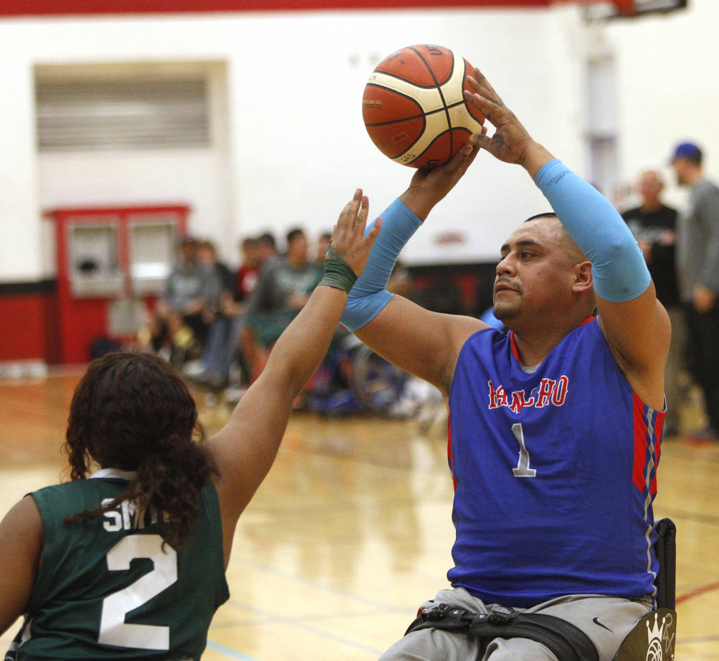 Rancho Renegades Jose Rodriguez (1) attempts to shoot past Las Vegas Yuccas Kiya Smith (2) during the Wheelchair Basketball Division I-II Tournament at UNLV in Las Vegas, Sunday, Jan. 6, 2019. Las ...