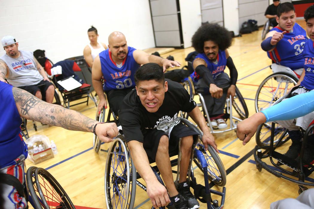 Rancho Renegades coach Ramon Cervantes cheers with his team at the end of a timeout during the Wheelchair Basketball Division I-II Tournament at UNLV in Las Vegas, Sunday, Jan. 6, 2019. Las Vegas ...