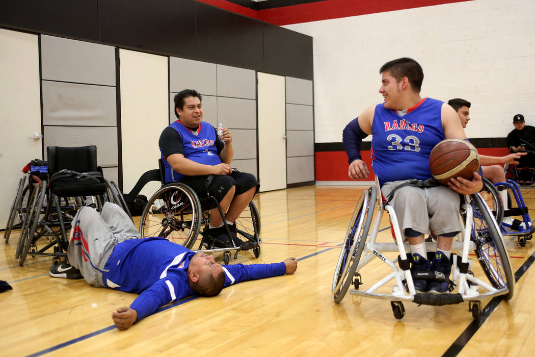 Rancho Renegades Jose Rodriguez (1), from left, rests with teammates Alexander Peralta (4) and Gilmar Arana (33) during a break in a game against the Las Vegas Yuccas at the Wheelchair Basketball ...