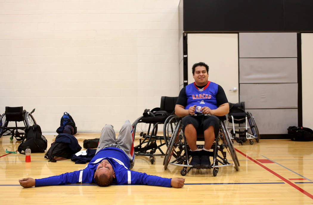 Rancho Renegades JosŽ Rodriguez (1), left, rests with teammate Alexander Peralta (4) during a break in a game against the Las Vegas Yuccas at the Wheelchair Basketball Division I-II Tourname ...