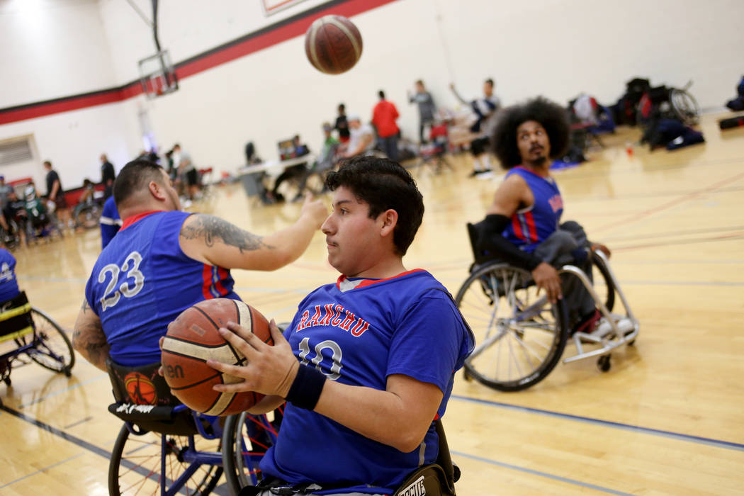 Rancho Renegades Genaro Perez (10) practices shooting hoops with teammates during a break in a game against the Las Vegas Yuccas at the Wheelchair Basketball Division I-II Tournament at UNLV in La ...