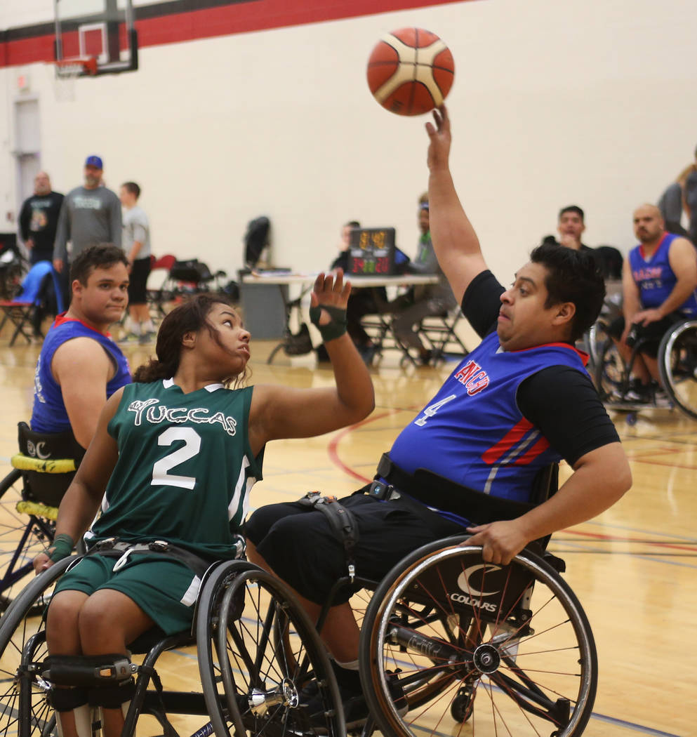 Rancho Renegades Alexander Peralta (4) attempts to pass the ball past Las Vegas Yuccas Kiya Smith (2) at the Wheelchair Basketball Division I-II Tournament at UNLV in Las Vegas, Sunday, Jan. 6, 20 ...