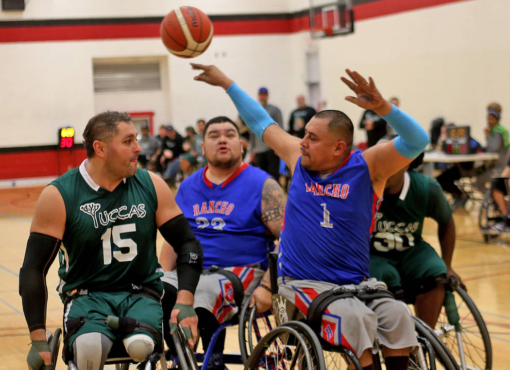 Rancho Renegades Jose Rodriguez (1) throws the ball back to teammate Duron Hector (23) during a game against the Las Vegas Yuccas at the Wheelchair Basketball Division I-II Tournament at UNLV in L ...