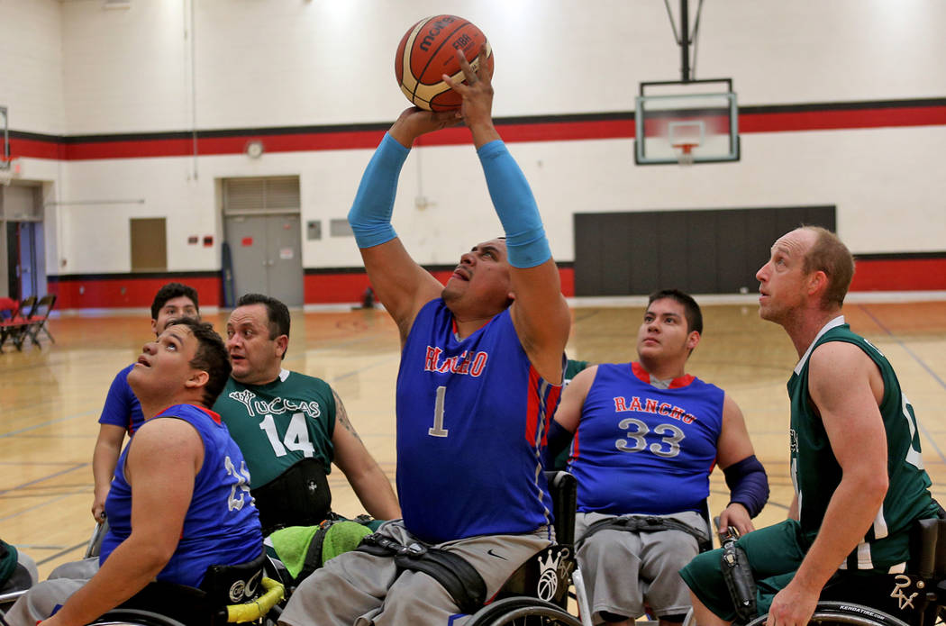 Rancho Renegades Jose Rodriguez (1) attempts a shot against the Las Vegas Yuccas at the Wheelchair Basketball Division I-II Tournament at UNLV in Las Vegas, Sunday, Jan. 6, 2019. Las Vegas Yuccas ...