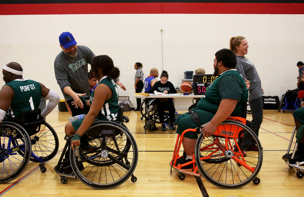 Las Vegas Yuccas coach Jonathan Foster shakes hands with his player Kiya Smith (2) after the game against the Rancho Renegades at the Wheelchair Basketball Division I-II Tournament at UNLV in Las ...