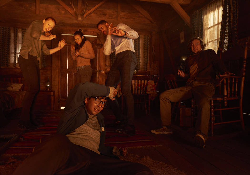 """This image released by Sony Pictures shows Deborah Ann Woll, clockwise from left, Taylor Russell, Jay Ellis, Logan Miller and Nick Dodani in """"Escape Room."""" (David Bloom/Sony Pictures via AP)"""