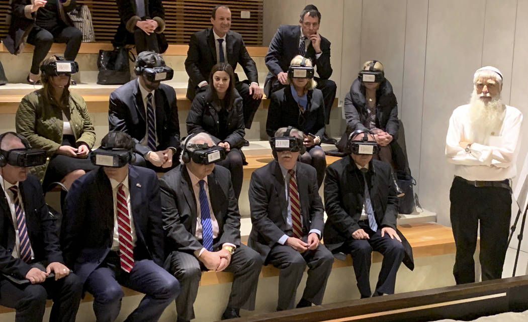 U.S. National Security Adviser John Bolton, seated front row forth from left, participates in a virtual reality demonstration at the Western Wall on Sunday, Jan. 6, 2019, in Jerusalem. U.S. Ambass ...