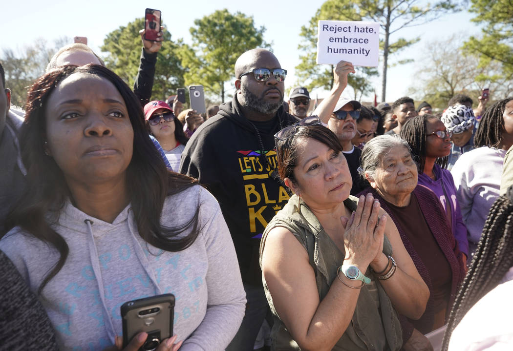 People attend a community rally for seven-year-old Jazmine Barnes on Saturday, Jan. 5, 2019 in Houston. Barnes was killed when a driver shot into the car she and her family were driving in last ...
