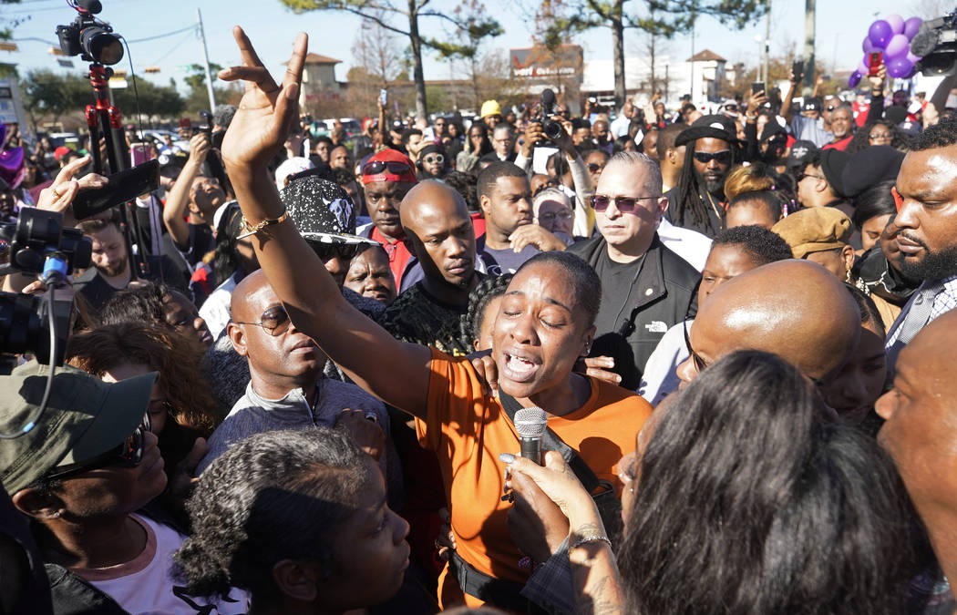 LaPorsha Washington, center, the mother of seven-year-old daughter Jazmine Barnes, who was killed on Sunday, speaks to the crowd during a community rally outside Walmart, Saturday, Jan. 5, 2019, i ...