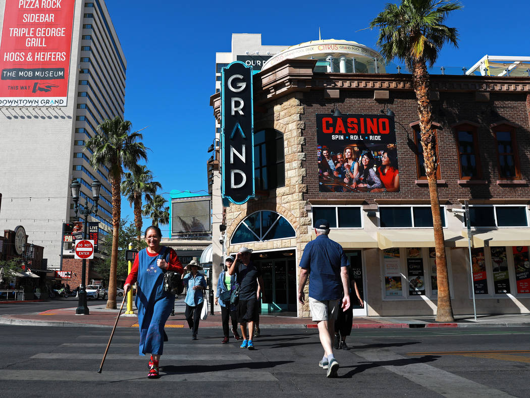 People walk along 3rd Street near the Downtown Grand hotel-casino in Las Vegas on Tuesday, May 15, 2018. (Las Vegas Review-Journal)