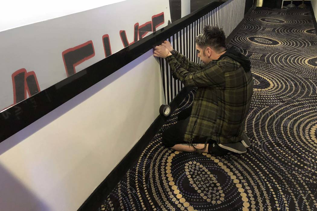 Tape Face is shown performing some taping at the entrance of the House of Tape on Wednesday, March 14, 2018 (John Katsilometes/Las Vegas Review-Journal) @JohnnyKats