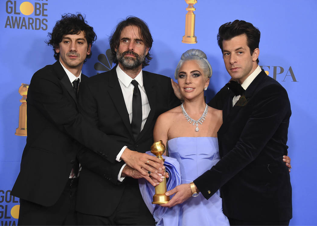 "Anthony Rossomando, from left, Andrew Wyatt, Lady Gaga and Mark Ronson pose in the press room with the award for best original song, motion picture for ""Shallow"" from the film ""A St ..."