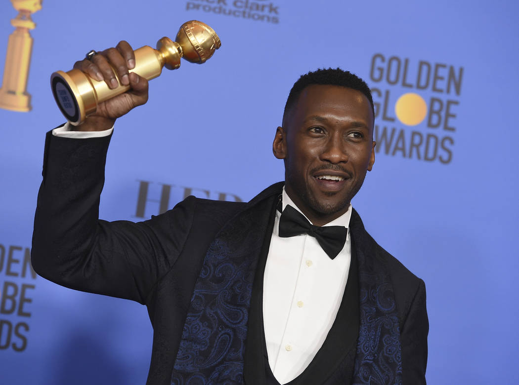"Mahershala Ali poses in the press room with the award for best performance by an actor in a supporting role in any motion picture for ""Green Book"" at the 76th annual Golden Globe Awards ..."