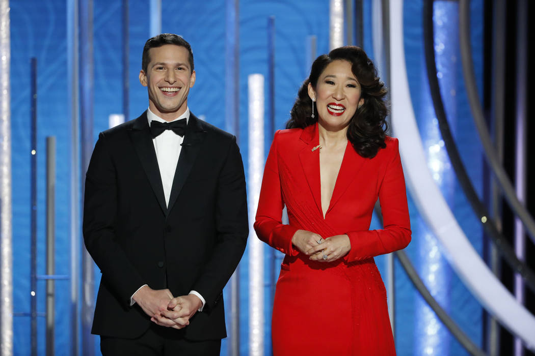 This image released by NBC shows hosts Andy Samberg, left, and Sandra Oh at the 76th Annual Golden Globe Awards at the Beverly Hilton Hotel on Sunday, Jan. 6, 2019, in Beverly Hills, Calif. (Paul ...