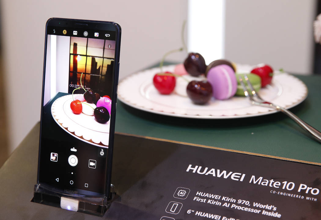 In this Jan. 9, 2018, file photo the Huawei Mate10 Pro phone is displayed at the Huawei booth during CES International in Las Vegas. The CES 2019 gadget show, which kicks off Sunday, will showcase ...