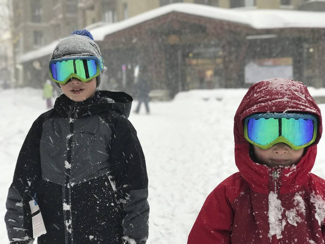 This photo provided by Michael Patrick O'Neill shows his sons Liam, left, and Finn in the snow at Squaw Valley, Lake Tahoe, Calif., on Sunday, Jan. 6, 2019. A winter storm swept through par ...