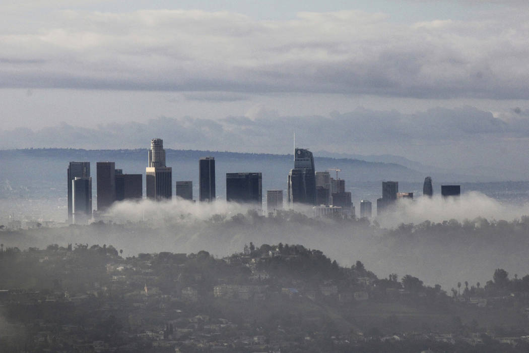 High-rises of downtown Los Angeles rise above clouds and mist on Sunday, Jan. 6, 2019, after an overnight storm that brought rain and mountain snow to Southern California. (AP Photo/John Antczak)