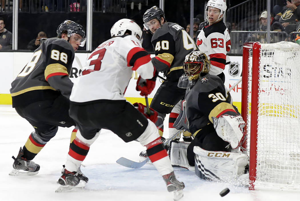 Vegas Golden Knights goalie Malcolm Subban (30) blocks a shot during the third period of an NHL hockey game against the New Jersey Devils, Sunday, Jan. 6, 2019, in Las Vegas. (AP Photo/Isaac Brekken)