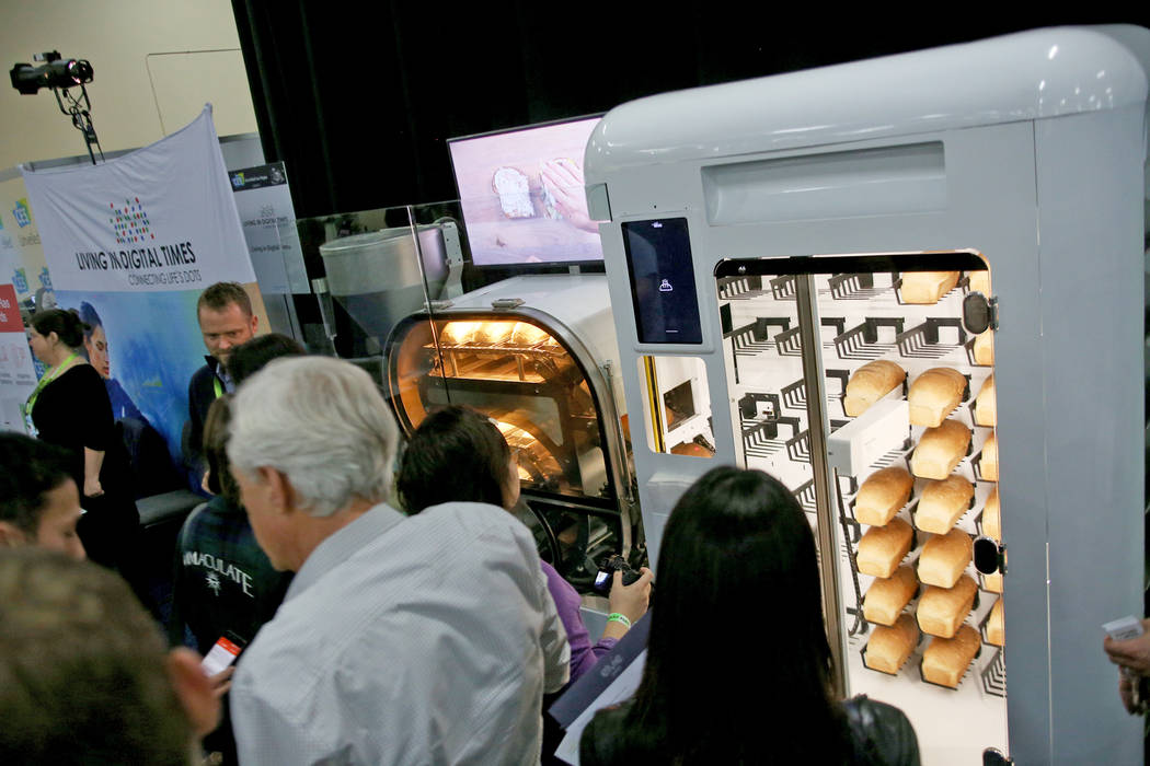 A fully automated bread machine called the Bread Bot, that creates bread from dough to baked loaf, on display at the CES Unveiled event for media prefacing the tech mega-conference at Mandalay Bay ...