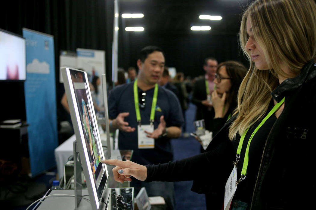 Francesca Vengel uses Perfect Corp.'s YouCam Makeup app to change her makeup at the CES Unveiled event for media prefacing the tech mega-conference at Mandalay Bay in Las Vegas, Sunday, Jan. 6, 20 ...