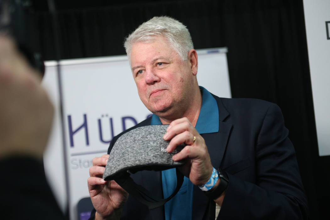Curtis Ray, founder of HYpnos, holds the HYpnos sleep mask that is a self-learning snore-reduction mask at the CES Unveiled event for media prefacing the tech mega-conference at Mandalay Bay in La ...