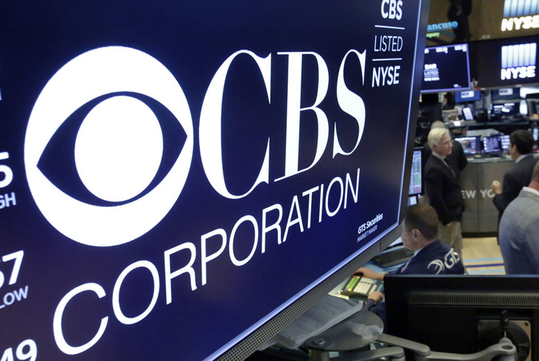 In this July 30, 2018, photo the logo for CBS Corporation is displayed above a trading post on the floor of the New York Stock Exchange. (AP Photo/Richard Drew)