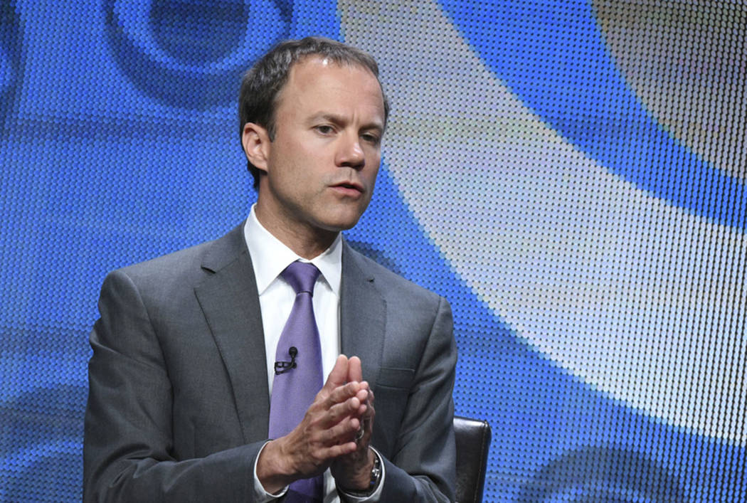 In this Aug. 10, 2015, photo, David Rhodes, president of CBS news division, participates in the CBS News panel at the CBS Summer TCA Tour at the Beverly Hilton Hotel in Beverly Hills, Calif. (Pho ...