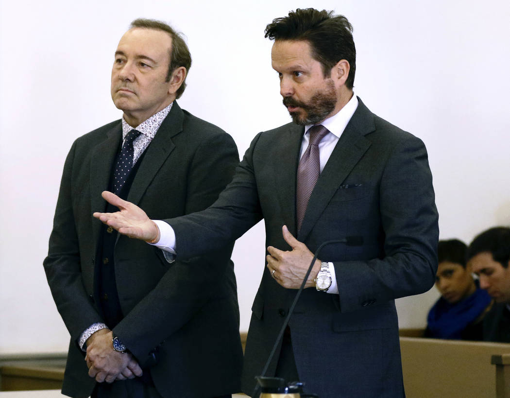 Actor Kevin Spacey stands in district court as his attorney Alan Jackson, right, addresses the judge during arraignment on a charge of indecent assault and battery on Monday, Jan. 7, 2019, in Nant ...