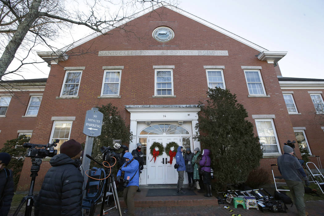 Members of the news media stand outside the Nantucket Town & County Building, awaiting arrival of actor Kevin Spacey for arraignment on a charge of indecent assault and battery, Monday, Jan. 7 ...
