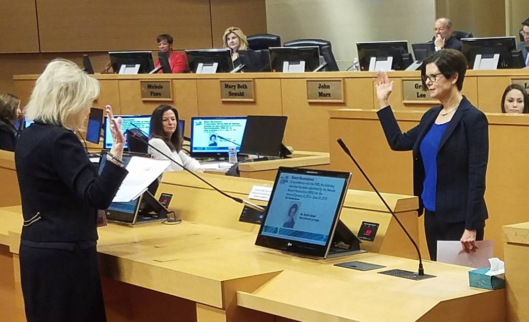 Clark County District Court Judge Nancy Allf swears in a new member to the Las Vegas Convention and Visitors Authority board of directors on Tuesday, Jan. 8, 2019. Joining the board is Marilyn Spi ...