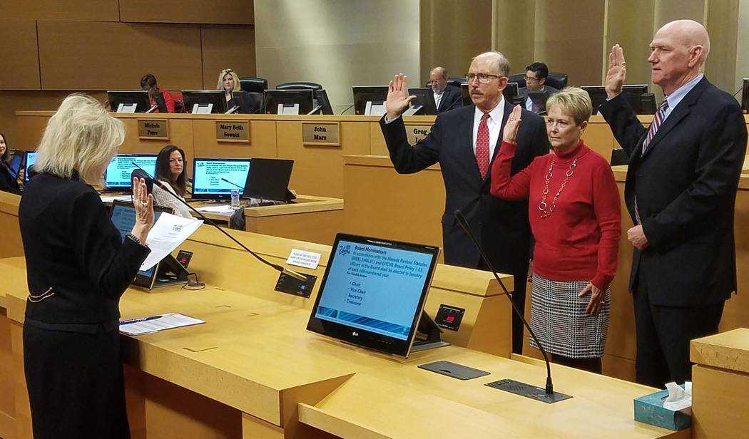 Clark County District Court Judge Nancy Allf swears in new officers for the Las Vegas Convention and Visitors Authority board of directors on Tuesday, Jan. 8, 2019. New officers include Bill Noona ...