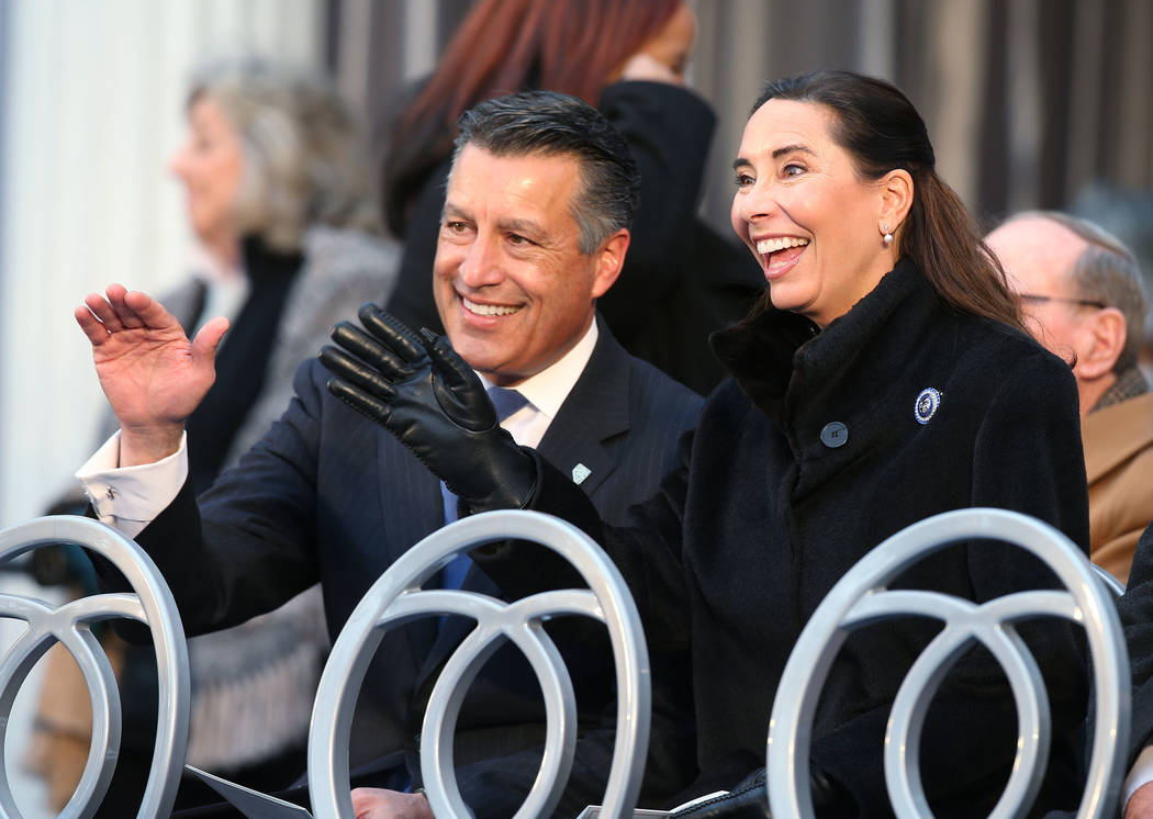Former Gov. Brian Sandoval and his wife Lauralyn wave to members of the crowd before the inauguration at the Capitol, in Carson City, Nev., on Monday, Jan. 7, 2019. (Cathleen Allison/Las Vegas Rev ...