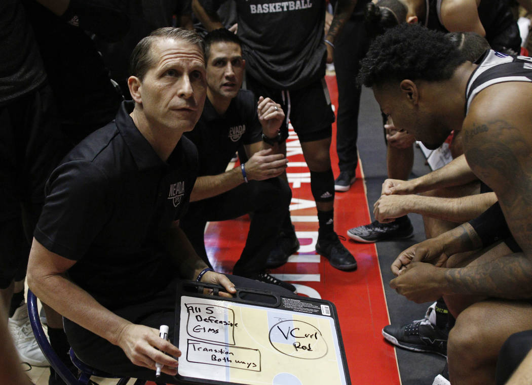 UNR head coach Eric Musselman gives instructions to his players before the start of an NCAA college basketball game against New Mexico in Albuquerque, N.M., Saturday, Jan. 5, 2019. (AP Photo/Andre ...