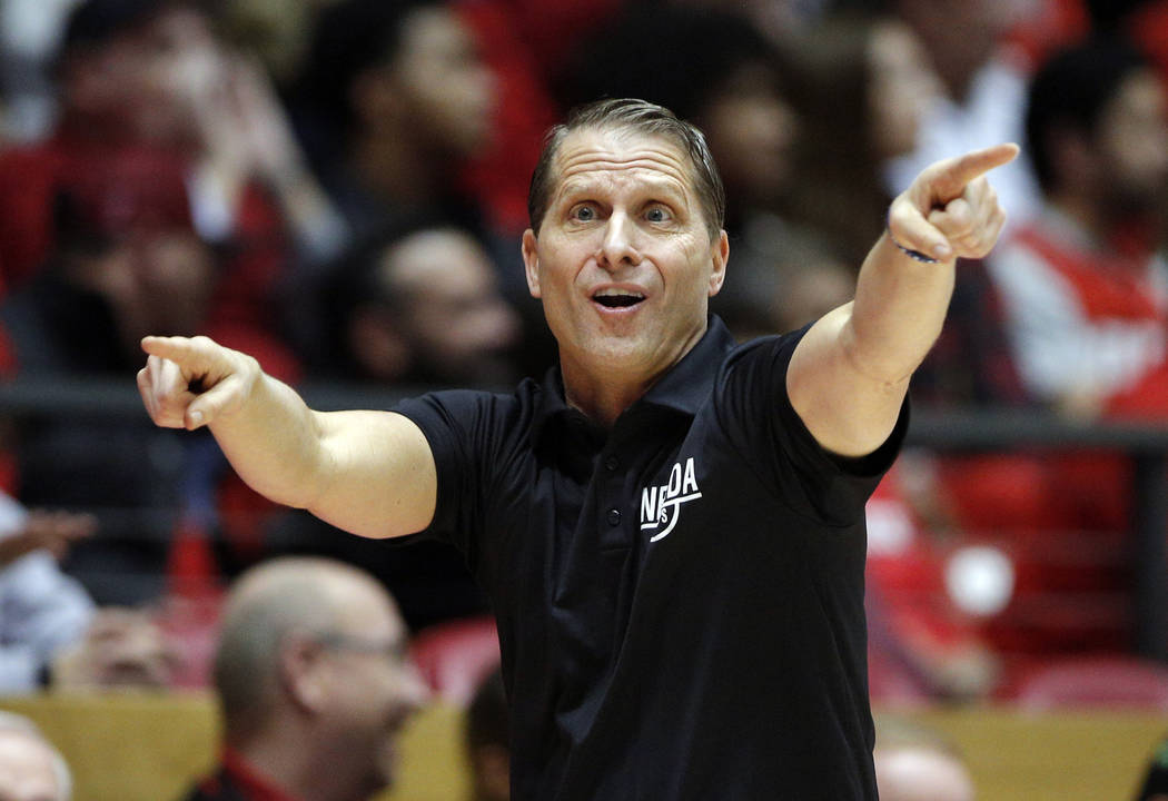 UNR head coach Eric Musselman gives instructions to his players from the sideline during the second half of an NCAA college basketball game against New Mexico in Albuquerque, N.M., Saturday, Jan. ...