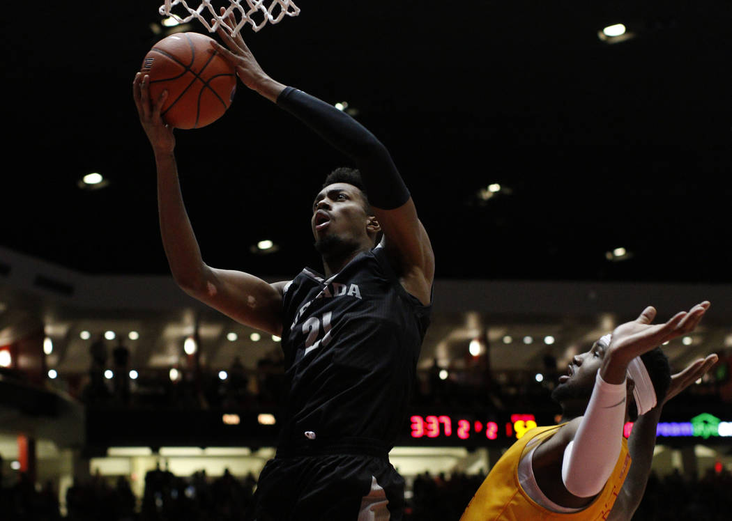 UNR forward Jordan Brown, left, goes up for a basket against New Mexico forward Carlton Bragg during the second half of an NCAA college basketball game in Albuquerque, N.M., Saturday, Jan. 5, 2019 ...