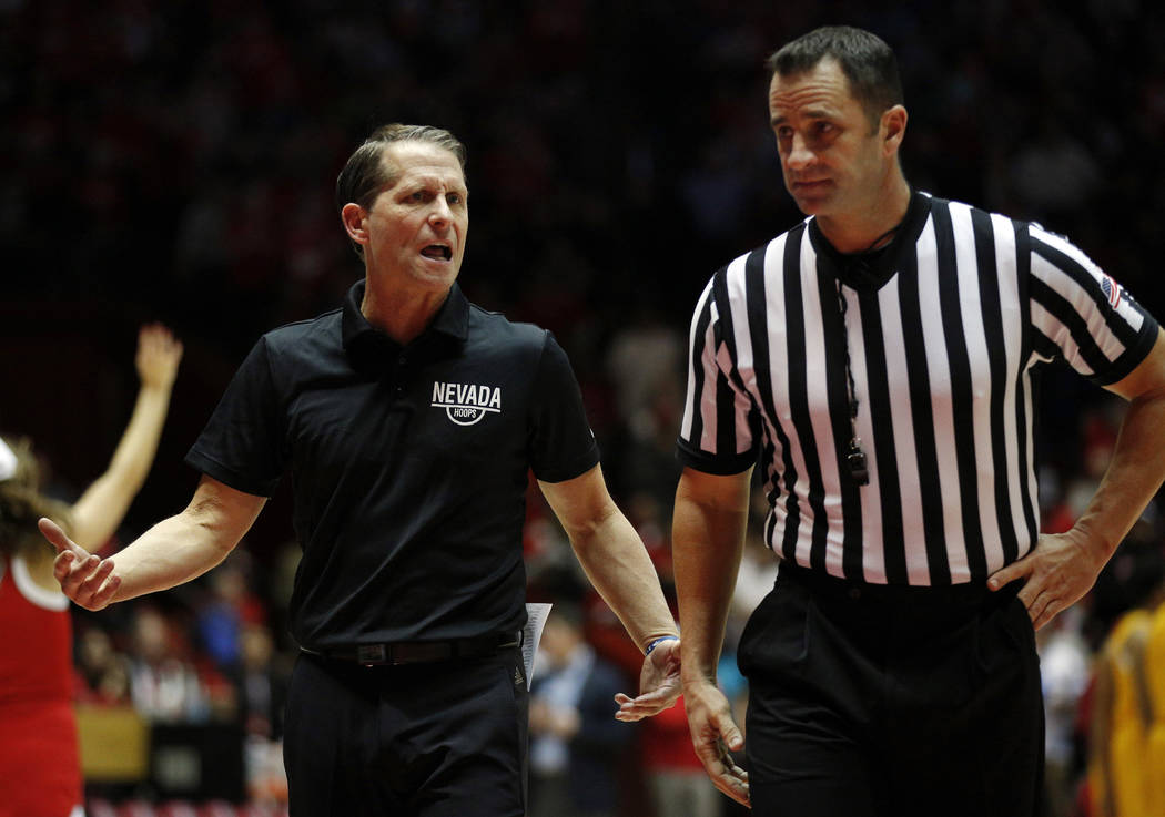 UNR head coach Eric Musselman, left, argues with official D.G. Nelson during the second half of an NCAA college basketball game against New Mexico in Albuquerque, N.M., Saturday, Jan. 5, 2019. (AP ...
