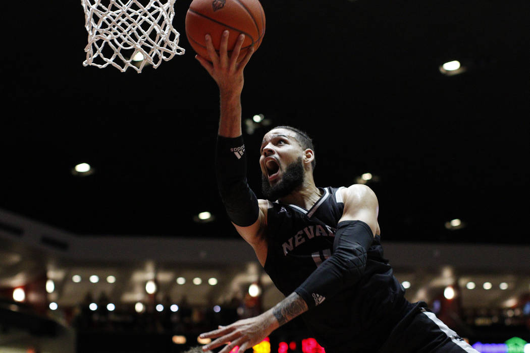 UNR forward Cody Martin drives for a layup against New Mexico during the second half of an NCAA college basketball game in Albuquerque, N.M., Saturday, Jan. 5, 2019. New Mexico won 85-58. (AP Phot ...